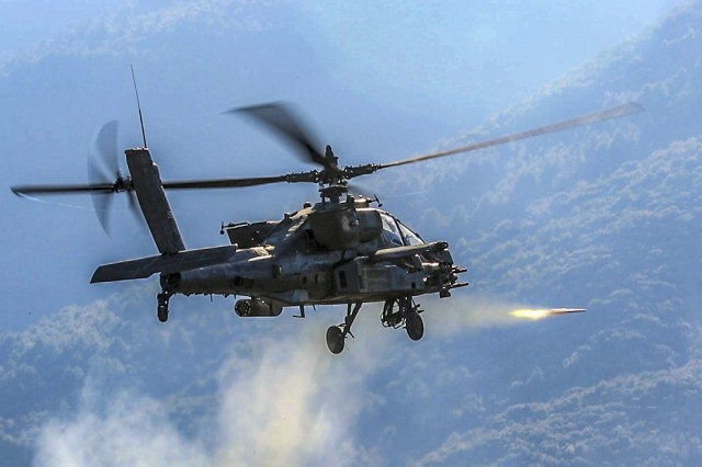 An AH-64 Apache helicopter with the 6th Squadron, 17th Cavalry Regiment, 4th Combat Aviation Brigade, fires a Hydra 70 rocket during a combined arms live fire exercise at Litochoro, Greece, Jan. 23, 2019. Allied and partner forces train together frequently from strategically positioned bases in Europe that are critical for a timely and coordinated response to any aggression.