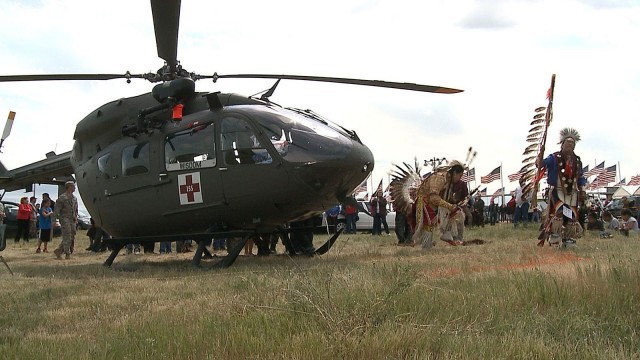 Two members of the Standing Rock Sioux Nation dance in traditional attire around a South Dakota Army National Guard UH 72 Lakota helicopter on June 10, 2012 after a blessing ceremony for the helicopter. The SDNG and the Lakota Nation have partnered together to support the people living on the reservations as well as to help inspire the youth to become active members of the community.