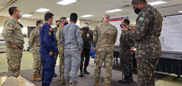 Military officers from Brazil, Colombia and Peru conduct mission analysis as part of the Planning in Crisis exercise Oct. 28 hosted by U.S. Army South and held at Joint Base San Antonio-Fort Sam Houston, Texas, Oct. 26-30. The exercise allowed partner nations from the Western Hemisphere to plan and develop an operation order with component commands in preparation for the U.S. Southern Command PANAMAX exercise. PANAMAX is an annual U.S. Southern Command-sponsored training exercise series with the objective of demonstrating the capability of participating nations to conduct coalition operations and is focused on ensuring the security of the Panama Canal and the surrounding region.