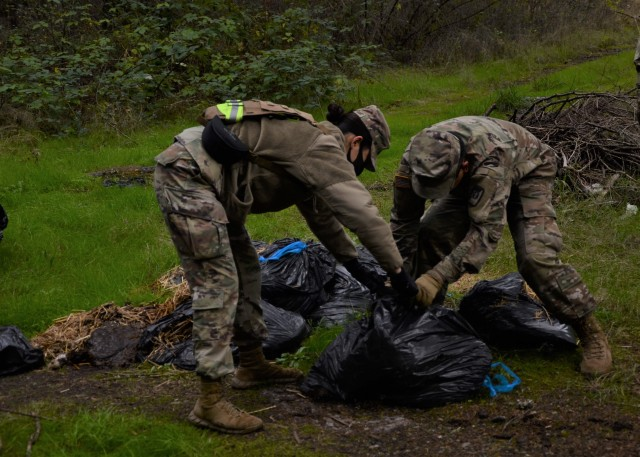 Soldiers collect illegally dumped trash during fall cleanup on Joint Base Lewis-McChord. Since Oct. 26, more than 400 service members have spent over 20,000 man-hours to collect and haul away more than 128 tons, which is 256,000 pounds, of trash from the training areas on base.