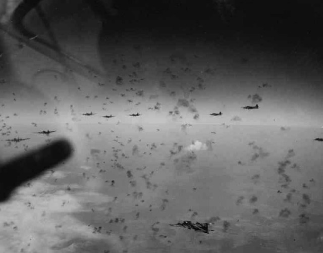 B-17 Flying Fortress bombers fly through antiaircraft artillery fire over Merseberg, Germany, in November 1944.