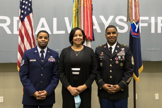 From Left, U.S. Air Force Tech. Sgt. Eldridge Rouse, Evelyn Rouse and U.S. Army 1st Sgt. Tyris Rouse stand together to take a family photo at U.S. Army Central headquarters on Shaw Air Force Base, S.C., Oct. 7, 2020. The Rouse family came together to attend Tyris' retirement ceremony which turned out to be a surprise reunion for Eldridge and the family. (U.S. Army photo by Pfc. Keon Horton)