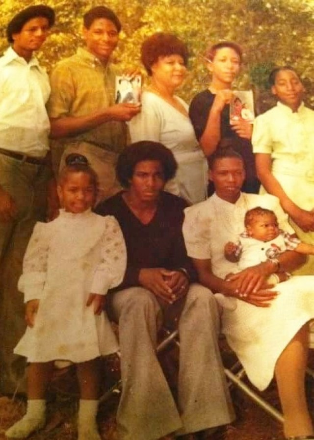 McGaffeny family photo were taken in the 1981,  McComb, Mississippi. Family members holding pictures of siblings that were not able to make the photo shoot. Charquilla is at bottom left corner. (Courtesy photo)