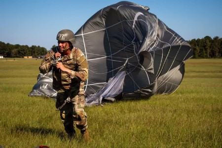 A trainee completes their qualifying jump during Jump Week at U.S. Army Airborne School, Fort Benning, Ga.