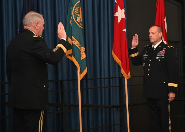Gen. Mike Murray, Commanding General of Army Futures Command, administers the Oath of Office to Lt. Gen. D. Scott McKean after his promotion at Camp Mabry, Texas, Nov. 2, 2020. Following the promotion, McKean assumed responsibilities as Deputy Commanding General, Army Futures Command and Director, Futures and Concepts Center. (U.S. Army photo by David Miller)