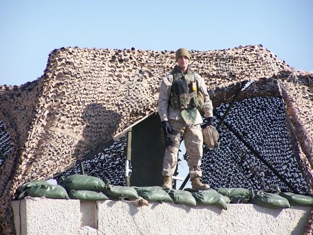 Jonathan Glaze, AMCOM information technology specialist, takes a photo outside Fallujah, Iraq during Operation Phantom Fury, Dec. 2004. (Courtesy photo)