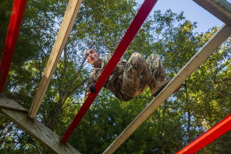 Army Spc. Ivan Torres-Leon navigates a weaver obstacle during the 2020 Army Reserve Best Warrior Competition at Fort McCoy, Wis., Sept. 5, 2020.