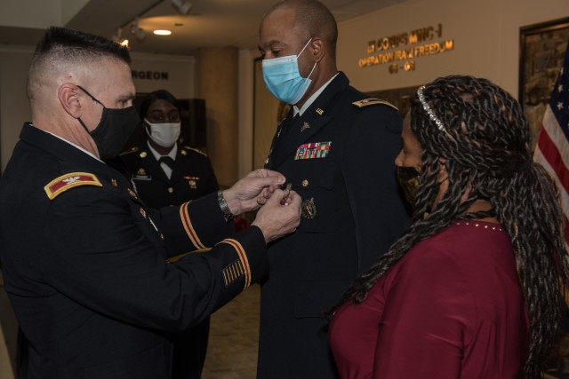 Maj. Sterling Coleman, receives the Meritorious Service Medal during the Phantom Honors ceremony Oct. 30.  Coleman retired after 21 years of honorable service as the human resources manager for Headquarters and Headquarters Detachment, 9th Hospital Center, 1st Medical Brigade.