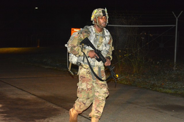Sgt. James Gabisum, assigned to Landstuhl Regional Medical Center, completes the road march portion of the Regional Health Command Europe Best Warrior competition Nov. 3 and 4 in Baumholder.  Gabisum was the winner in the 'noncomissioned officer' category.