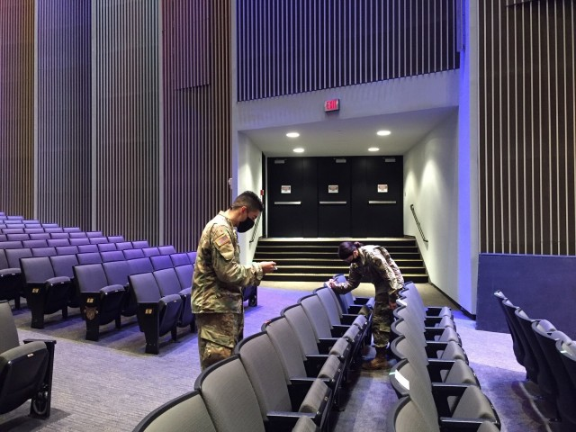 """USMA Class of 2022 Cadet Andy Rodriguez, left, and Class of 2024 Cadet Emily Hobbs, right, mark off seats in Eisenhower Hall Theatre Sept. 10 ahead of the """"We Stand Together"""" concert at the U.S. Military Academy at West Point featuring Platinum artist Riley Green along with Travis Denning and Matt Mulhere. Several safety measures were put in place to prevent a potential spread of COVID-19 during the live concert. (U.S. Army photo by Col. Mindy Kimball)"""