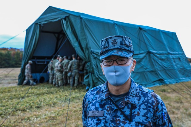 Japan Air Self-Defense Force Capt. Masataka Uchii, operations officer, Headquarters, Northern Air Defense Force, visits bilateral Air Defense partners Battery A, 1st Battalion, 1st Air Defense Artillery Regiment at a northern Honshu training site, Misawa Air Base, Japan during the Keen Sword 21, an exercise aimed at enhancing joint bilateral Missile Defense and Air Defense capabilities through training with U.S. Air Force fighters/aircraft, U.S. Army Patriot, and Japan Air Self-Defense Force Air and Missile Defense units.