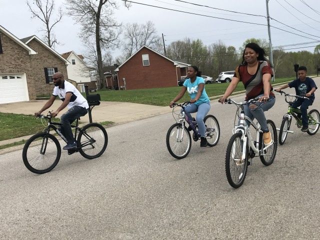 """David Allen, left, and his wife Wanda, right, ride bicycles with their children Caniyah Hampton, 12 and L. J. Hampton, 8, in their neighborhood. Fort Campbell Ready and Resilient Program performance experts encourage everyone to remain connected with loved ones, especially during the holiday season. """"It plays a huge role into resilience, and personally, whether it's talking on the phone or online, it's really important to maintain connections during this time,"""" said Courtney Folkes, performance expert-master resilience trainer for Fort Campbell Ready and Resilient Program."""