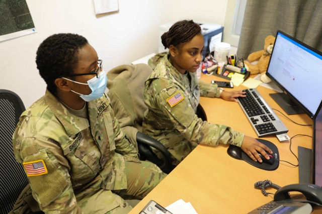 """MIHAIL KOGALNICEANU, ROMANIA -- Staff Sgt. Breanna Gray, Non-Commissioned Officer in Charge, Troop Medical Clinic, and one of her Soldiers, Spc. Laneeja Sheppard, Senior Medic, MK Aid Station, review a daily task report to plan for what needs to be accomplished. """"She's always squared away. She doesn't forget my tasks or her tasks and we both have a million things to do. Even while she is doing her job, she reminds me, make sure you check on this, make sure you do that,"""" said Sheppard. """"You can ask Staff Sgt. Gray to do anything and she can get it done."""" (U.S. Army photo by Sgt. H. Marcus McGill)"""