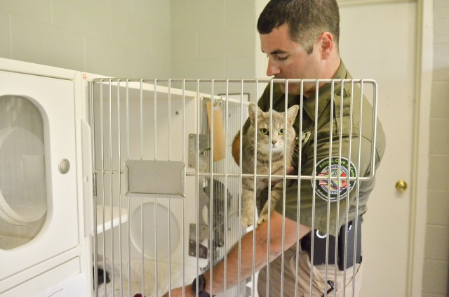 Justin Slate, animal control officer, cares for a cat waiting for adoption at the Fort Campbell An-imal Shelter. Fort Campbell's first intergovernmental support agreement was signed June 6, 2019, when Montgomery County Animal Care and Control took over the Fort Campbell Stray Animal Facility and its operations. The Stray Animal Facility IGSA is projected to have a savings of more than $550,000 over a five-year period.