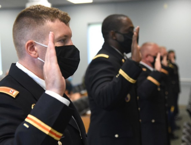 U.S. Army Reserve and Virginia National Guard candidates swear in as new warrant officers during a graduation ceremony at the conclusion of Warrant Officer Candidate School, hosted by the Fort Pickett-based 183rd Regiment, Regional Training Institute at Fort Pickett, Virginia. (U.S. National Guard photo by Mike Vrabel)