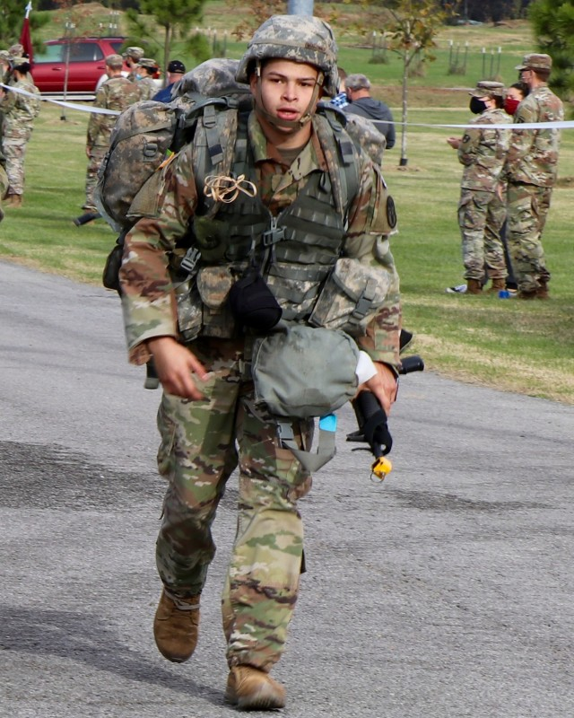 Spc. Joshua Martinez, a dental specialist assigned to the Fort Campbell Dental Activity, Fort Campbell, Kentucky approaches the finish line after successfully completing a 12-mile timed ruck march, Nov. 5, during an Expert Field Medical Badge test on Fort Campbell. Martinez was one of 38 Soldiers on Fort Campbell who qualified for the badge during EFMB testing Oct. 24 to Nov. 5. EFMB is a special skill award for recognition of exceptional competence and outstanding performance by field medical personnel, enabling a ready medical Force through elevated medical proficiency. U.S. Army photo by Maria Yager.