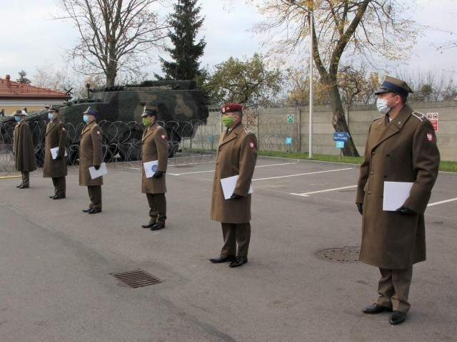 Polish Soldiers assigned to Headquarters, Multinational Division-North East participate in a small ceremony on Nov. 10 in Elblag, Poland, in honor of Poland's Independence Day which would occur the following day on Nov. 11.