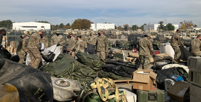 Soldiers with the 526th Brigade Support Battalion, 2nd Brigade Combat Team, 101st Airborne Division (Air Assault) go through items pulled out of their storage containers Nov. 5 to see what needs to be kept, thrown away or recycled as part of Operation Clean Eagle, the 101st Airborne Division's postwide cleanup effort designed to enhance readiness and quality of life by properly maintaining Fort Campbell's training and cantonment areas.