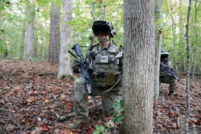 Soldier dons the Capability Set 3 (CS 3) militarized form factor prototype of the Integrated Visual Augmentation System (IVAS) during a Soldier Touchpoint 3 (STP 3) squad reconnaissance mission test event at Fort Pickett, Va., in October 2020.