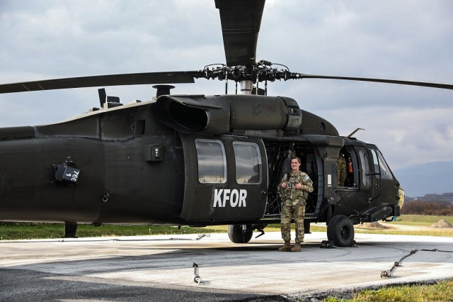 Warrant Officer Kristina Multani stands at the ready next to a UH-60 Black Hawk as she prepares for her first flight during the 28th rotation of the Kosovo Forces mission, Nov.6, 2020 at Camp Bondsteel Kosovo. Multani, who finished flight school in September as the only female warrant officer UH-60 pilot in the Delaware Army National Guard, eagerly embraced the opportunity to deploy to Kosovo.