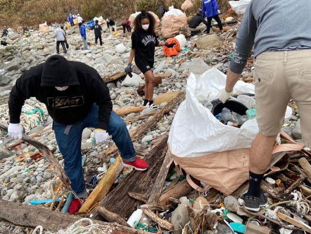 Soldiers from the 14th Missile Defense Battery at the Kyogamisaki Communication Site at Kyotango-Shi, Japan, picks up trash as part of a community cleanup of Suisho-hama Beach, Nov 8. The battery, operated by the U.S. Army Space and Missile Defense Command's 1st Space Brigade, does almost monthly cleanups of surrounding beaches during the warm months of the year. (Courtesy photo by Katsuro Shintaro)