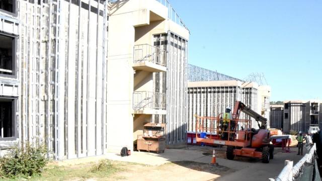 Contractors work on refurbishing barracks on Mississippi Avenue as part of Fort Polk's Barracks Modernization Program.