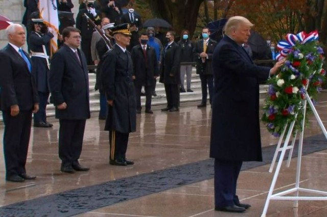 President Donald J. Trump, Vice President Mike Pence and Robert Wilkie, secretary of Veterans Affairs, participate in a ceremony at the Tomb of the Unknown Soldier at Arlington National Cemetery, Nov. 11, 2020.