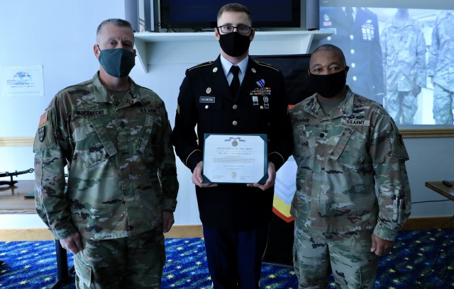 Sgt. Robert W. Redmond (center), military police, 14th Missile Defense Battery, displays his Army Achievement Medal, alongside interim Command Sgt. Maj. George S. Rupprecht (left), 38th Air Defense Artillery Brigade senior enlisted advisor, and Lt. Col. James L. Crenshaw (right), brigade deputy commanding officer, after winning the title NCO of the Quarter during the Pacific Guardian of the Quarter Competition closing ceremony at Sagami General Depot Nov. 17. Eight Soldiers and noncommissioned officers assigned to various units throughout 38th ADA Brigade competed in a grueling test of their physical and mental abilities during a quarterly contest Nov. 16-17.