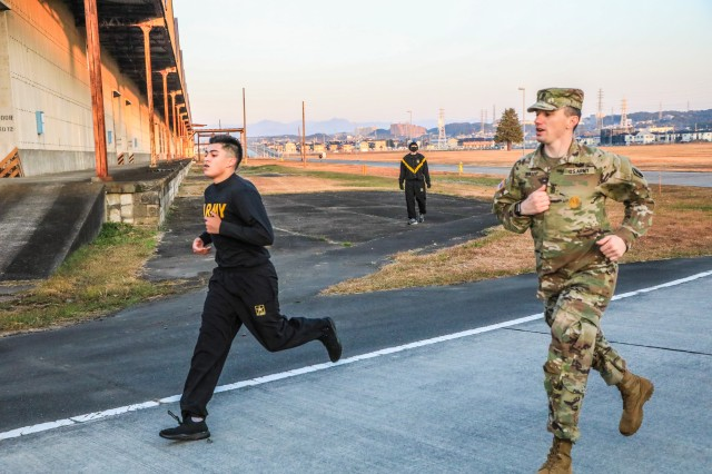 SAGAMIHARA, Japan – Pfc. Izak S. Ramirez, Patriot fire control enhanced operator/maintainer, runs with 1st Sgt. Michael C. Miller, both with the 10th Missile Defense Battery, during two-mile run portion of the Army Combat Fitness Test event of the 38th Air Defense Artillery Brigade Pacific Guardian of the Quarter Competition at Sagami General Depot Nov. 16. Ramirez placed as runner-up Soldier of the Quarter.