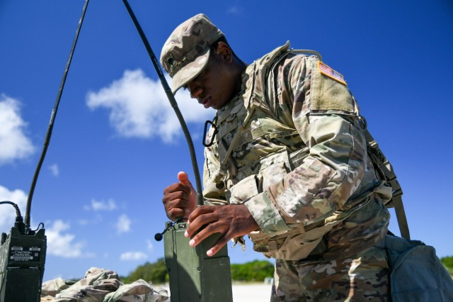 ANDERSEN AIR FORCE BASE, Guam – Spc. Asher E. Goodwin, petroleum supply specialist with Echo Battery, 3rd Air Defense Artillery Regiment, Terminal High Altitude Area Defense, completes the Single Channel Ground and Airborne Radio System programing proficiency assessment while being timed during the Pacific Guardian of the Quarter Competition here, Nov. 16. Eight Soldiers and noncommissioned officers assigned to various units throughout 38th Air Defense Artillery Brigade competed in a grueling test of their physical and mental abilities during a quarterly contest Nov. 16-17. (U.S. Army photo by 1st Lt. Joyce Borja)
