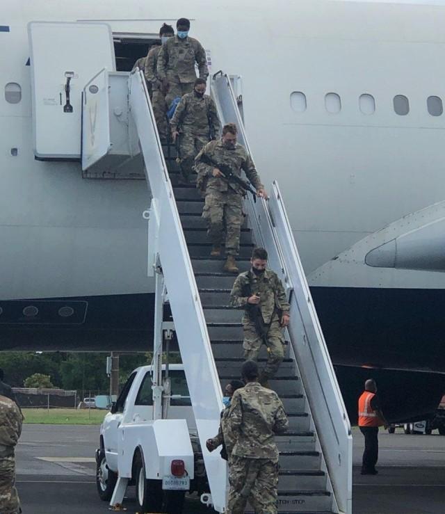 Soldiers disembark their return flight from Fort Polk, Louisiana.