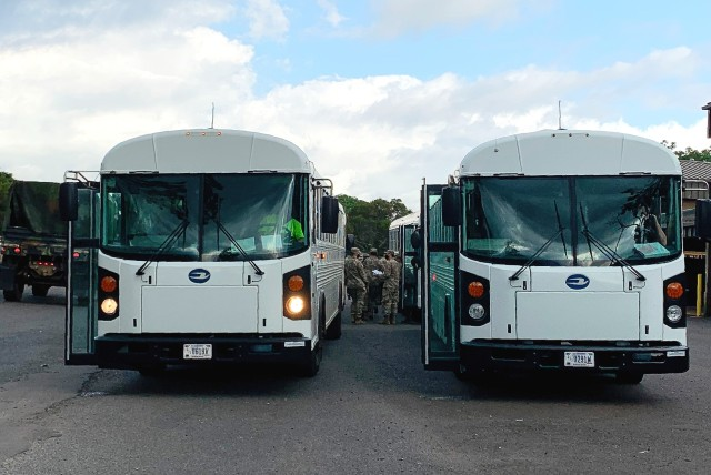 Buses wait for returning Soldiers at Hickam Airfield to bring them back to Schofield Barracks. All Soldiers and Department of Army Civilians took a COVID-19 test prior to their flights back to Hawaii and will complete a 14-day restriction of movement to ensure they are COVID-free.