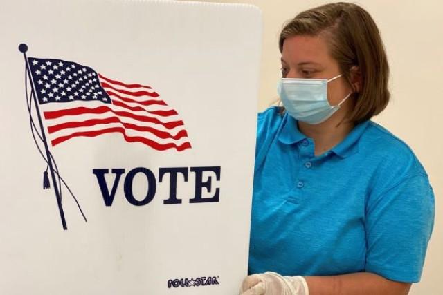 OTC Cadet Alyssa Skorich sanitizes a voting station at the Anthony Stratton Building in Lawrenceburg, Ky., June 12, 2020.