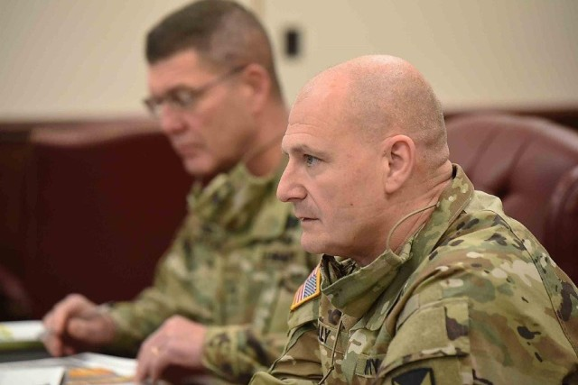 Gen. Ed Daly, commanding general, U.S. Army Materiel Command, listens along with Maj. Gen. Daniel Mitchell, commanding general, U.S. Army Sustainment Command, during a quarterly update meeting for Daly Nov. 19 at ASC on Rock Island Arsenal, Illinois. Daly served as the ASC commanding general from August 2016 to July 2017.
