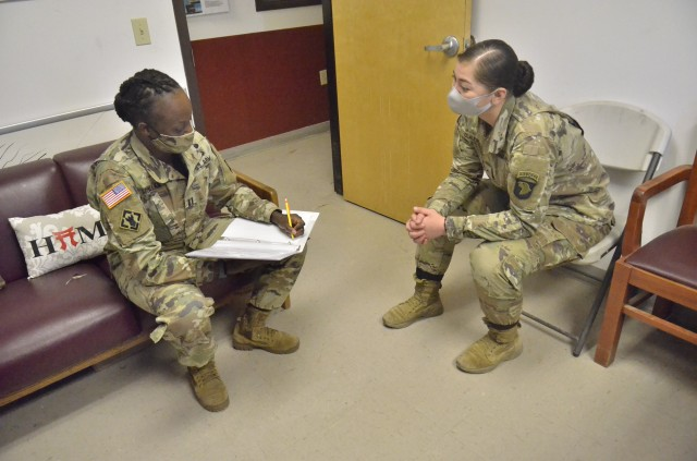 Captain Naseyah McMillan, special projects officer with the Fort Campbell Directorate of Public Works and executive officer of Headquarters and Headquarters Company, 101st Combat Avia-tion Brigade, 101st Airborne Division (Air Assault), conducts a survey about barracks amenities, Nov. 16, with Pvt. 2 Lisset Claudio, 1st Battalion, 187th Infantry Regiment, 3rd Brigade Com-bat Team, 101st Abn. Div.