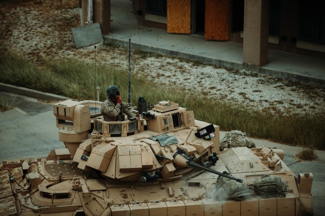 Troopers assigned to 1st Battalion, 12th Cavalry Regiment, 3rd Armored Brigade Combat Team, 1st Cavalry Division, engage an opposing force during the testing of the newest version of the Bradley Fighting Vehicle, Fort Hood, Texas, Oct. 24, 2020. Operational testing with the U.S. Army Operational Test Command (OTC), places First Team Troopers in a series of maneuvers and engagements where OTC can properly test the new vehicles. (U.S. Army photo by Sgt. Calab Franklin, 3ABCT, 1CD, PA NCOIC)
