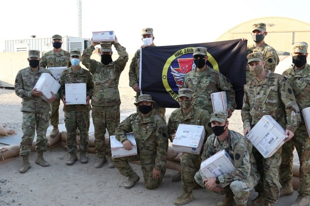 U.S. Soldiers with the 28th Expeditionary Combat Aviation Brigade pose for a photo after receiving care packages from Lily Palfrey, daughter of 1st Sgt. Frank Palfrey who is the senior enlisted advisor for Headquarters and Headquarters Company, 28th Expeditionary Combat Aviation Brigade.