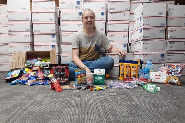 Lily Palfrey, daughter of 1st Sgt. Frank Palfrey who is the senior enlisted advisor for Headquarters and Headquarters Company, 28th Expeditionary Combat Aviation Brigade, organized 154 care packages to be sent to her father's deployed unit.