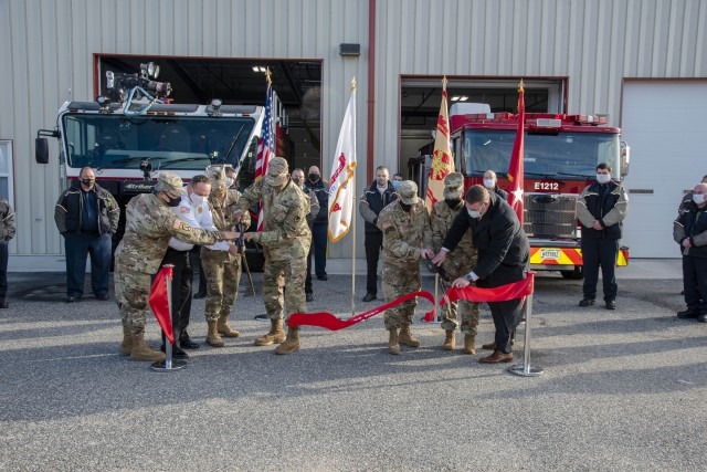 From left, APG Garrison Chaplain Lt. Col. Young Kim; Fire Chief Adam Ballard, APG Fire & Emergency Services; Communications-Electronics Command Sgt. Maj. Kristie Brady; APG Senior Commander Maj. Gen. Mitchell Kilgo; APG Garrison Commander Col. Timothy Druell and APG Garrison Command Sgt. Maj. Ruth Drewitt participate in a ribbon cutting ceremony to celebrate the completion of the renovation and expansion of Fire Station #2 on Phillips Airfield Nov. 19.