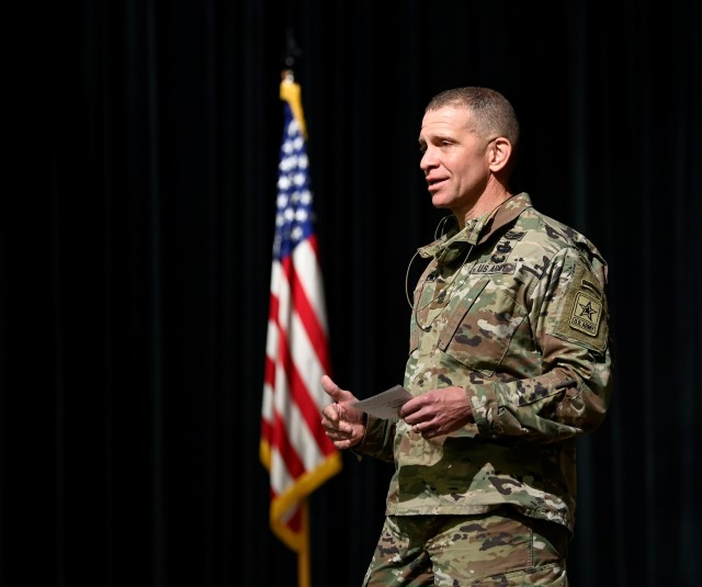 Sergeant Major of the Army Michael A. Grinston presents Retention Awards to Noncommissioned Officers during a ceremony at Fort Bragg, North Carolina November 19, 2020. (U.S. Army photo by K. Kassens)