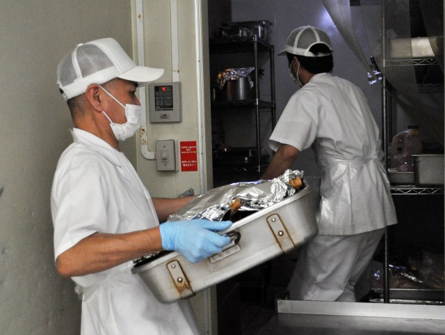 Cooks at the Camp Zama Dining Facility, place food in the refrigerator as they prepare the traditional Thanksgiving luncheon at Camp Zama, Japan, Nov. 23.
