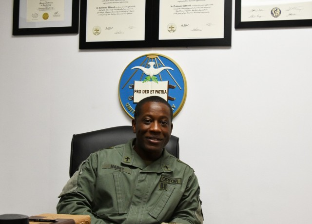 Chap. (Capt.) Jamar Mabry, Joint Readiness Training Center Operations Group, at his desk.