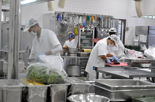 Cooks at the Camp Zama Dining Facility, prepare the traditional Thanksgiving luncheon at Camp Zama, Japan, Nov. 25.