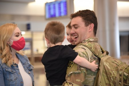 A Soldier greets his Family at Salt Lake City International Airport, Oct. 6, 2020, after returning home from his deployment.