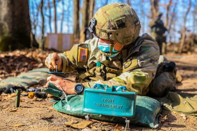 """U.S. Army 1st Lt. Codi Morris, platoon leader, 2nd Battalion, 327th Infantry Regiment """"No Slack"""", 1st Brigade Combat Team """"Bastogne"""", 101st Airborne Division (Air Assault), prepares a claymore mine during Expert Infantry Badge training Nov. 20 at  the Expert Infantrymen Badge and Expert Soldier Badge testing site on Fort Campbell, Kentucky. 738 candidates across the brigade train to earn their EIB and ESB proving their mastery of the fundamentals and basic Soldier skills within their profession. U.S. Army photo by Sgt. Lynnwood Thomas"""