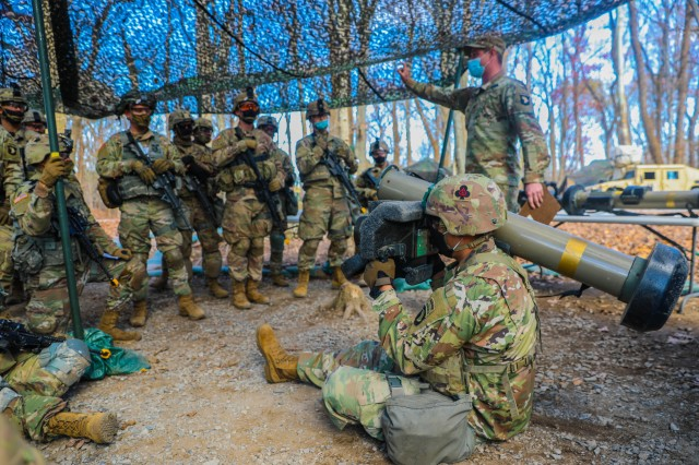 """Soldiers from 1st Brigade Combat Team """"Bastogne"""", 101st Airborne Division (Air Assault), gather around a Soldier demonstrating the proper use of a Javelin Nov. 20 at the Expert Infantrymen Badge and Expert Soldier Badge testing site on Fort Campbell, Kentucky. 738 candidates across the brigade train to earn their EIB and ESB proving their mastery of the fundamentals and basic Soldier skills within their profession. U.S. Army photo by Sgt. Lynnwood Thomas"""
