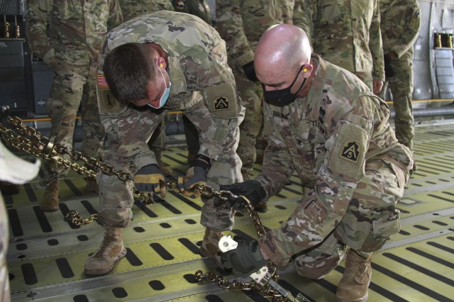 Col. Charles Brundrett, U.S. Army North's Task Force 51's operations officer, right, and Lt. Col. Jeremy Gottshall, U.S. Army North Task Force 51's logistic officer in charge work together to chain down a vehicle, during the unit's Level II Deployment Readiness Exercise (DRE), at Joint Base San Antonio Lackland Kelly Field Annex, Texas, Nov. 20, 2020. This exercise enhances the unit's deployment readiness while maintaining USARNORTH's forward capability in preparation for the 2021 hurricane season.