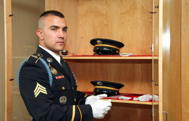 Then-Sgt. Adam Dickmyer preps his uniform in the tomb guard quarters beneath the stone plaza of the Tomb of the Unknown Soldier. Fellow Soldiers at the 3rd U.S. Infantry Regiment, or The Old Guard, said Dickmyer mentored them through difficult obstacles including the meticulous performance tests required to earn the Tomb of the Unknown Soldier Identification Badge. The native of Winston-Salem, N.C., was killed Oct. 28, 2010, when he was struck by an improvised explosive device in Afghanistan.