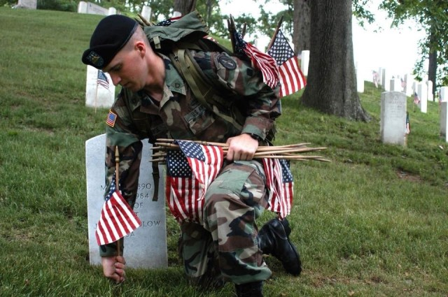 Then-Pfc. Ethan Morse lays American flags at gravestones in Arlington National Cemetery, Va. Morse served in The Old Guard, or 3rd Infantry Regiment, from 2003-2006 after enlisting as a paratrooper. Morse is now a filmmaker and producer living in the Los Angeles area.