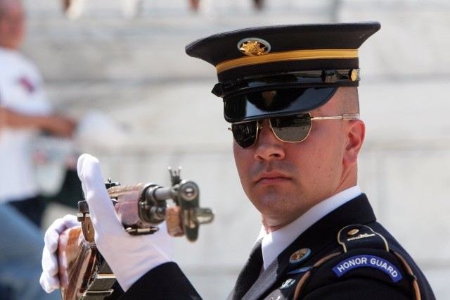 Staff Sgt. Adam Dickmyer inspects an M14 rifle during a changing of the guard inspection. Dickmyer was a respected squad leader and assistant sergeant of the guard at the Tomb of the Unknown Soldier in Arlington National Cemetery, Va. Oct. 28, 2020, marked the 10th anniversary of his death. Dickmyer was killed during a deployment to the Kandahar province of Afghanistan.